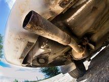 一辆老汽车的尾管 图库摄影