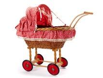 一辆老葡萄酒儿童的玩偶婴儿推车 图库摄影