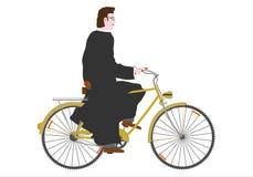 自行车的教士。 图库摄影