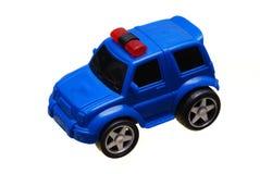 一辆蓝色玩具汽车警察小客车 免版税库存照片