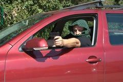 从一辆移动的汽车的刺客射击 免版税库存图片
