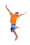 一逗人喜爱少年黑男孩跳跃的画象 免版税库存照片