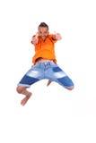 一逗人喜爱少年黑男孩跳跃的画象 图库摄影