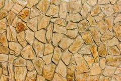 一部分的一个石墙,背景的褐色米黄口气或纹理 免版税库存图片