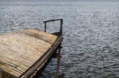 一部分的一条大小船在河股票照片附近停放了 图库摄影
