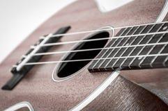 一部分的在灰色背景的一把声学吉他 库存照片