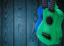 一部分的在蓝色木背景的一把声学吉他 库存照片