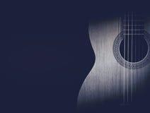 一部分的在黑背景的一把蓝色声学吉他 免版税图库摄影