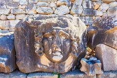 一部分的石头雕刻了装饰在阿波罗寺庙在Dydim 图库摄影