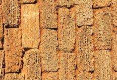 一部分的老棕色砖-泡沫块墙壁,纹理 图库摄影