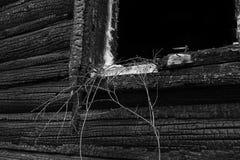 一部分的被烧的木窗口 图库摄影