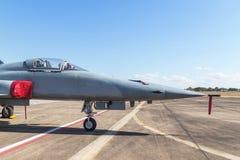 一部分的顶头喷气式歼击机军用飞机在基本的空军的跑道停放了 免版税库存照片