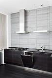 一部分的黑色硬木厨房 免版税库存图片