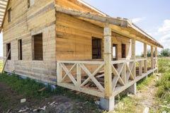 一部分的natu未完成的木生态传统村庄  库存照片
