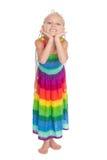 一件五颜六色的礼服的快乐的女孩 免版税库存图片