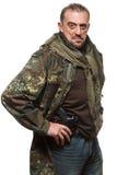 一件军用夹克的男性恐怖分子有枪的 免版税库存图片