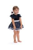 一件圆点礼服的小女孩在演播室 库存图片