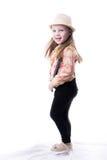 一件夏天帽子格子花呢披肩女衬衫和长裤的女孩有悬挂装置的 库存照片