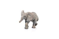 一头大象的缩样在白色背景的 库存图片