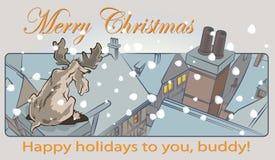 一头孤立鹿坐一个房子的屋顶多雪的圣诞节的 免版税图库摄影