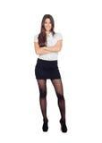一件时髦的超短裙的俏丽的女实业家 免版税库存照片