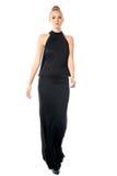 一件黑晚礼服的端庄的妇女 免版税库存照片
