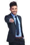 一轻松年轻商人指向的画象 免版税库存照片