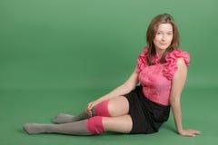 一件桃红色女衬衫的女孩 免版税库存照片