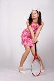 一件桃红色礼服的减速火箭的女孩 库存照片