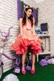 一件桃红色礼服的女孩在内部 库存图片