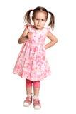 一件桃红色礼服的小女孩 免版税库存照片