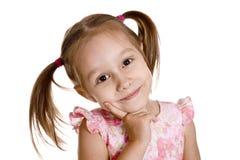 一件桃红色礼服的逗人喜爱的女孩 库存照片