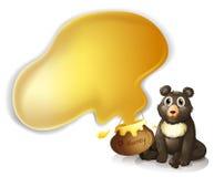 一头灰色熊和一个罐蜂蜜 皇族释放例证