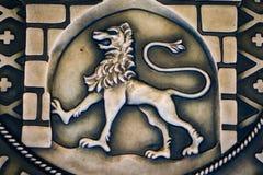 一头狮子的葡萄酒图象在金属的 免版税库存图片