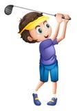一年轻男孩打高尔夫球 库存照片