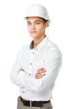 头戴一件白色盔甲的年轻工程师 图库摄影