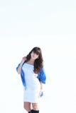 一件白色礼服的一个女孩 免版税库存照片