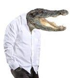 有鳄鱼的头的人 免版税库存照片