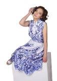 一件礼服的妇女有样式gzhel的 库存图片