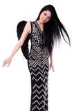一件黑礼服的美丽的少妇有黑天使的飞过 免版税库存图片
