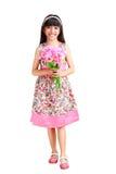 一件礼服的美丽的年轻亚裔女孩有一朵花的在她的手上 库存照片