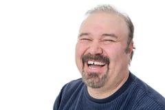 一滑稽成熟人笑的特写镜头画象 免版税库存图片