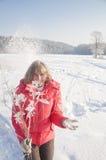 一件红色夹克的妇女 免版税图库摄影