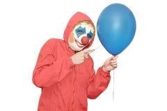 一件红色夹克的小丑 免版税图库摄影