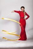 一件红色晚礼服的美丽的女孩 库存照片