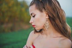 一件红色礼服的女孩1295 免版税库存图片