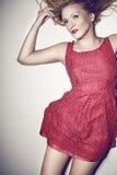 一件红色礼服的妇女 免版税库存图片