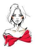 一件红色礼服的少妇有弓的 免版税库存图片