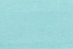从一份纺织材料的浅兰的背景与柳条样式,特写镜头 免版税库存图片