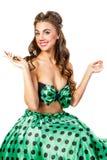 一件绿色礼服的女孩拿着她的头发锁  画报 免版税图库摄影